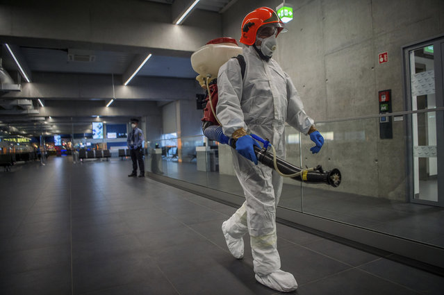 Disinfection equipment is carried by a worker as precautionary measures against the spreading of novel coronavirus, at Budapest Liszt Ferenc International Airport in Budapest, Hungary, Wednesday, February 5, 2020. So far almost 900 passenger arriving directly from China have been examined at the airport. (Photo by Zoltan Balogh/MTI via AP Photo)