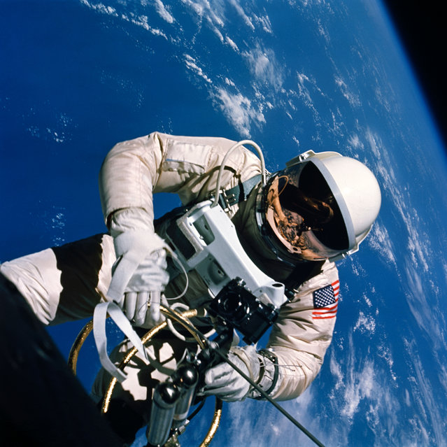 Astronaut Edward H. White II, pilot of the Gemini IV four-day Earth-orbital mission, floats in the zero gravity of space outside the Gemini IV spacecraft, on June 3, 1965. Behind him is the brilliant blue Earth and its white cloud cover. (Photo by NASA)