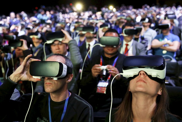 People wear Samsung Gear VR devices as they attend the launching ceremony of the new Samsung S7 and S7 edge smartphones during the Mobile World Congress in Barcelona, Spain, February 21, 2016. (Photo by Albert Gea/Reuters)