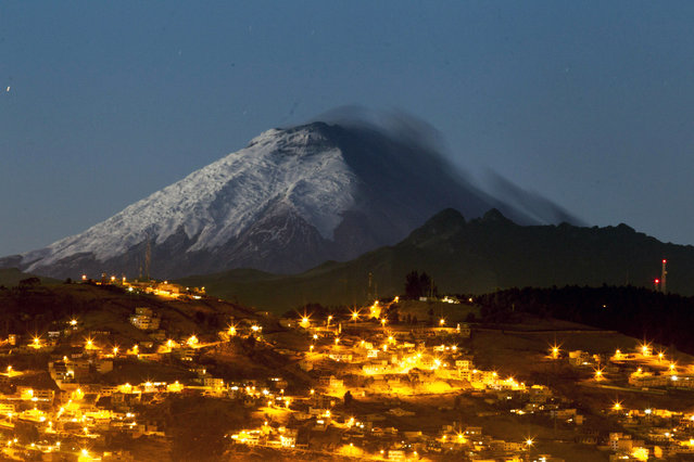 A general night view on the volcano Cotopaxi from Quito, Ecuador, early 18 August 2015. Ecuador's president on 15 August imposed a state of emergency in the country over concern that the volcano Cotopaxi might erupt. (Photo by Jose Jacome/EPA)