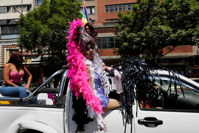 A reveller takes part in the gay pride parade in Caracas, Venezuela July 3, 2016. (Photo by Carlos Jasso/Reuters)