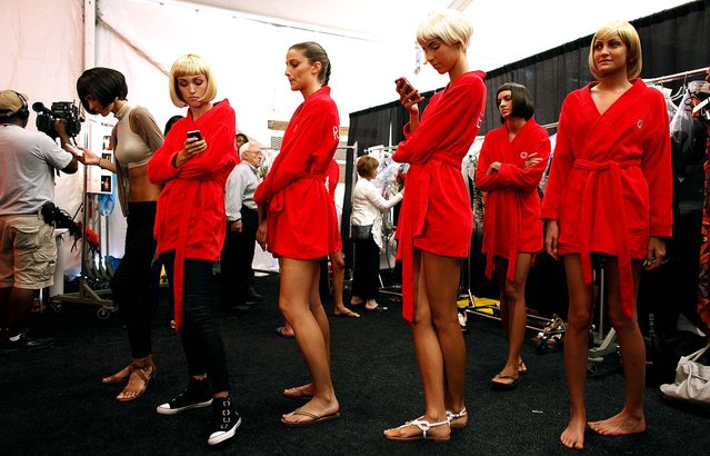 Models wait backstage to do a rehearsal for the Red Carter swimwear show during the Mercedes-Benz Fashion Week Swim 2013, Sunday, July 22, 2012, in Miami Beach, Fla. (AP Photo/Lynne Sladky)