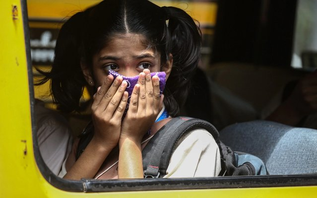 An Indian girl student covers her face as a precaution against the coronavirus outbreak, in Mumbai, India, 12 March 2020. According to media reports, more than 70 people in India have tested positive for COVID-19. The World Health Organisation declared the novel coronavirus or COVID-19 as global pandemic. (Photo by Divyakant Solanki/EPA/EFE/Rex Features/Shutterstock)