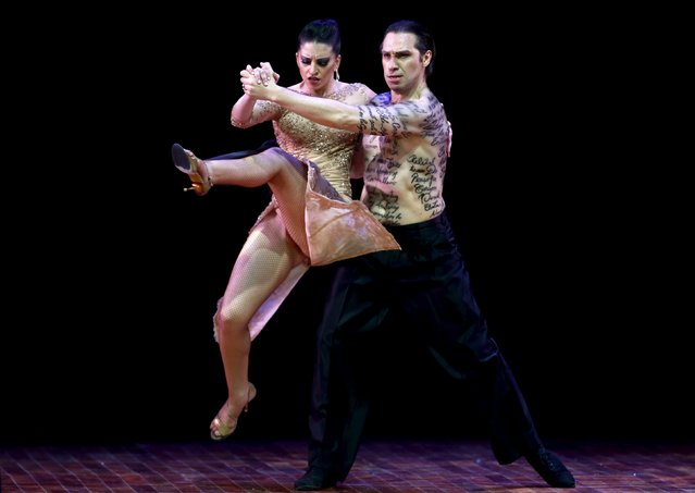 Hugo Mastrolorenzo (R) and Diana Pujol from Argentina, who are representing the city of Los Polvorines, dance during the Stage style final round at the Tango World Championship in Buenos Aires, Argentina, August 27, 2015. (Photo by Marcos Brindicci/Reuters)