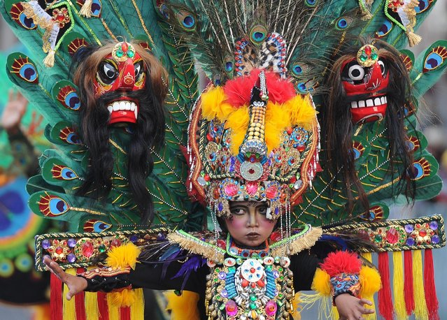 A model wears Reog outfit as part of Kids Carnival during 14th Jember Fashion Carnival on August 27, 2015 in Jember, Indonesia. The 14th Jember Fashion Carnival 2015 theme is Outframe and consists of ten parades, which include; Majapahit, Ikebana, Fossil, Parrot, Circle, Pegasus, Lionfish, Egypt, Melanesia, and Reog. (Photo by Robertus Pudyanto/Getty Images)