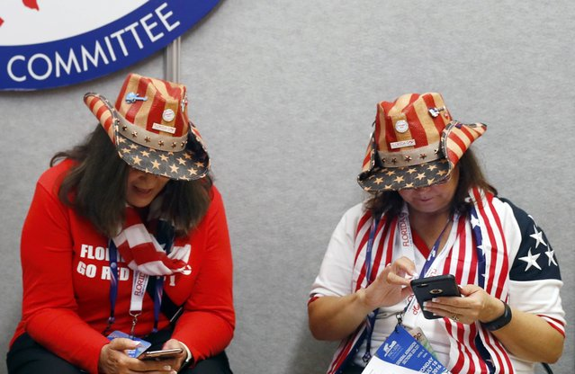 Florida delegates check their phones at the Republican National Convention in Cleveland, Ohio, U.S. July 18, 2016. (Photo by Aaron P. Bernstein/Reuters)