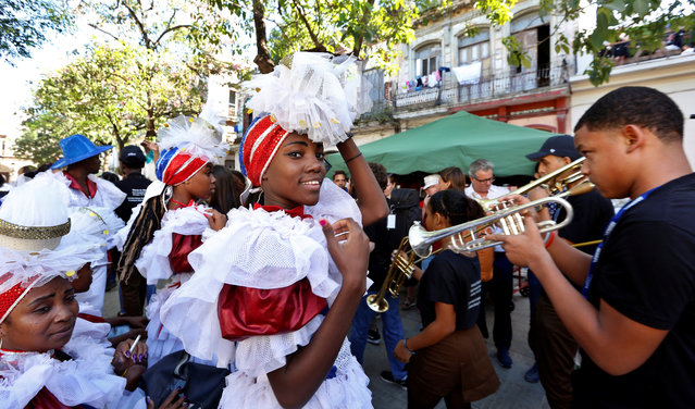 Artists and members of the public attend one of the activities of the International Jazz Plaza Festival in Havana, Cuba, 15 January 2020. The excitement of the New Orleans carnival merged with the traditional Cuban conga in a colorful parade that broke the monotony of an afternoon in Old Havana. (Photo by Ernesto Mastrascusa/EPA/EFE)