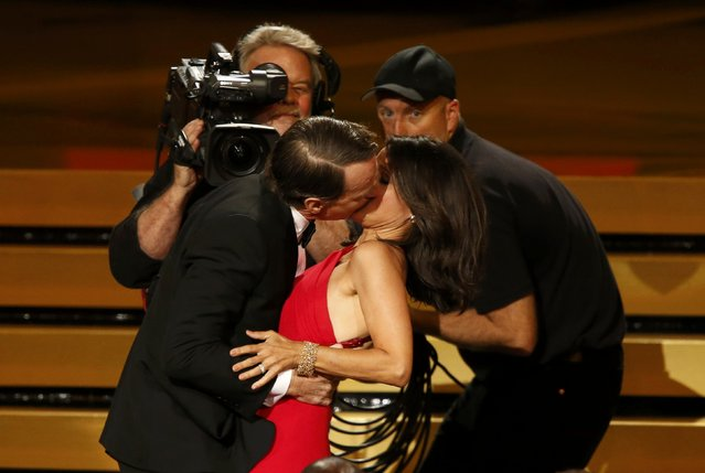 "Actor Bryan Cranston engages Julia-Louis Dreyfus in a prolonged kiss as she takes the stage to accept the award for Outstanding Lead Actress In A Comedy Series for her role in HBO's ""Veep"" during the 66th Primetime Emmy Awards in Los Angeles, California August 25, 2014. (Photo by Mario Anzuoni/Reuters)"