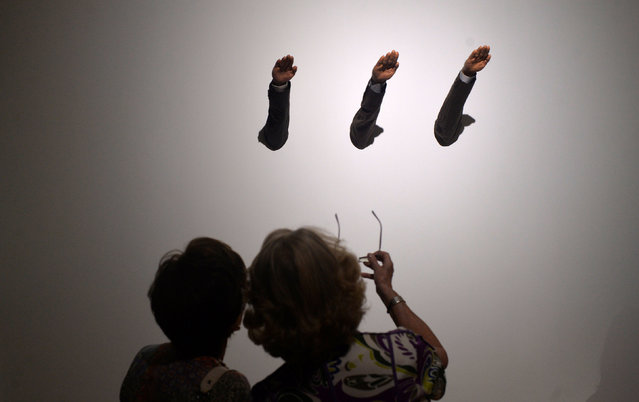 """Visitors observe the sculpture """"Ave Maria"""" by Italian artist Maurizio Cattelan, at the Hyperrealist Sculpture 1973-2016 exhibition in the Museum of Bellas Artes in Bilbao, northern Spain, July 27, 2016. (Photo by Vincent West/Reuters)"""