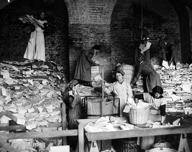 Women sorting paper for the London & South West Railway's scheme to clear out and recycle waste paper. United Kingdom, 16th April 1917. (Photo by Topical Press Agency)