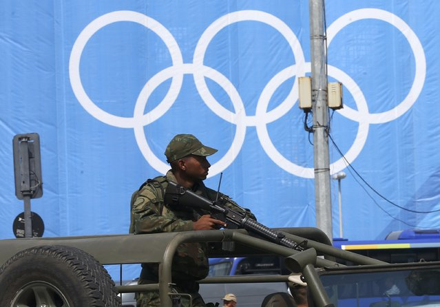 A soldier stands guard atop a vehicle in the Copacabana neighborhood, just a day before the opening ceremony of the Rio 2016 Olympic Games in Rio de Janeiro, Brazil, August 4, 2016. (Photo by Ruben Sprich/Reuters)