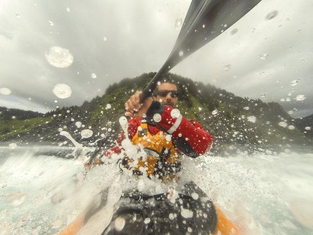 Daniel Fox splashes water into the camera as he kayaks around the stunning scenery, in June, 2014, in Afognak Island, Alaska. (Photo by Daniel Fox/Barcroft Media)