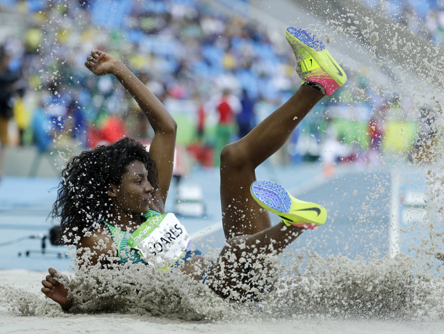 Brazil's Nubia Soares competes in a qualifying round of the women's triple jump during the athletics competitions of the 2016 Summer Olympics at the Olympic stadium in Rio de Janeiro, Brazil, Saturday, August 13, 2016. (Photo by Matt Dunham/AP Photo)