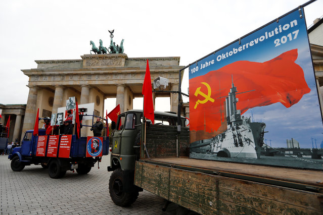 People take part in a parade to mark the Red October revolution's centenary in Berlin, Germany on November 7, 2017. (Photo by Fabrizo Bensch/Reuters)