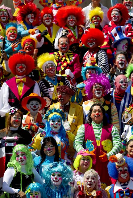 Clowns pose for the official photo at the XVII th Clown Convention in Mexico City. (Photo by Eduardo Verdugo/Associated Press)