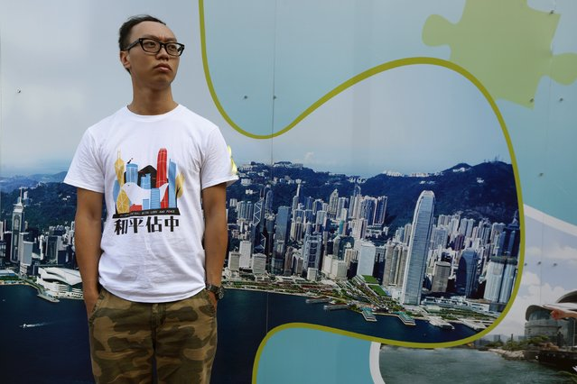"""Stanley Kwong, 30, a social worker, poses for a photograph during a rally ahead of an """"Occupy Central"""" civil disobedience protest in Hong Kong September 26, 2014. Kwong said, """"We have to voice out our ethical values and our conscience"""". (Photo by Bobby Yip/Reuters)"""