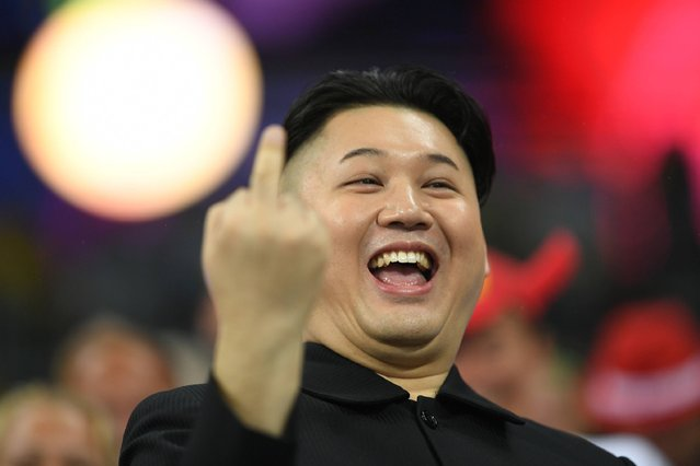 A man impersonating Kim Jong-un gestures during the athletics at the Rio 2016 Olympic Games at the Olympic Stadium in Rio de Janeiro on August 18, 2016. (Photo by Johannes Eisele/AFP Photo)