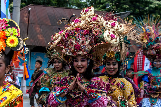Participants attend a carnival celebrating Indonesia's 71st Independence Day in Balige, North Sumatra, Indonesia on August 22, 2016. (Photo by Y.T. Haryono/Barcroft Media)
