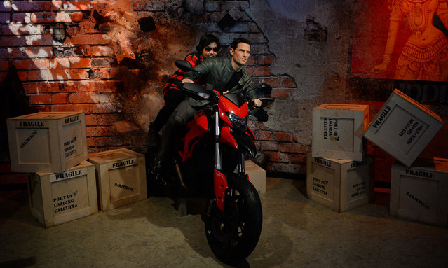 An Indian visitor sits on a bike with the wax statue of American actor Tom Cruise during the launch of Madame Tussauds Delhi in New Delhi on November 30, 2017. (Photo by Sajjad Hussain/AFP Photo)