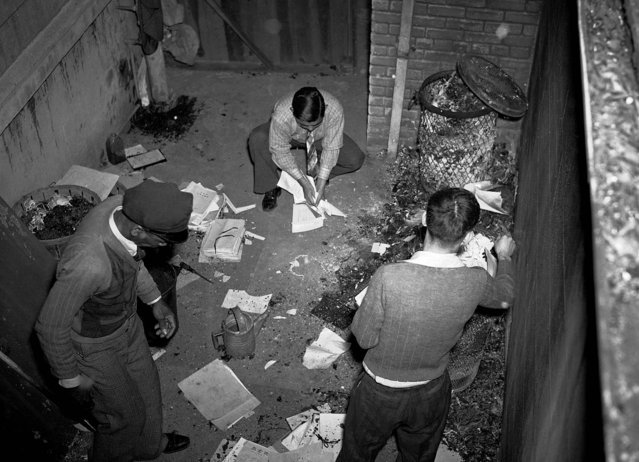 Attaches of the Japanese consulate began burning papers, ledgers and other records shortly after Japan went to war against the U.S., in New Orleans.  Police later stopped the fire after most of the papers had been destroyed. (Horace Cort/Associated Press)