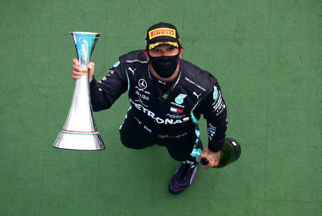 Mercedes' British driver Lewis Hamilton celebrates with the trophy on the podium of the Formula One Hungarian Grand Prix race at the Hungaroring circuit in Mogyorod near Budapest, Hungary, on July 19, 2020. (Photo by Mark Thompson/Reuters)