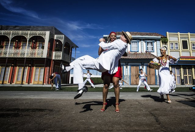 Brazilian performers Vanessa Nascimento holds Carlinhos de Jesus while dancing during the Rock in Rio USA sneak peak event, October 27, 2014, in Las Vegas. The permanent open-air concert venue sits on 37 acres with the capacity for 85,000 people per day. (Photo by Jeff Scheid/AP Photo/Las Vegas Review-Journal)