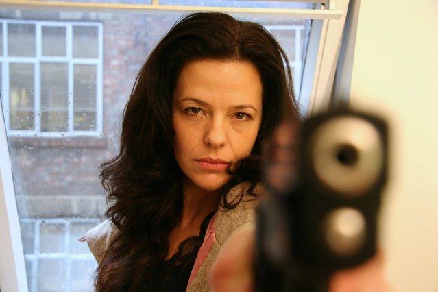"""""""Girl with gun"""". (Photo by Gavin and Jason Fox)"""
