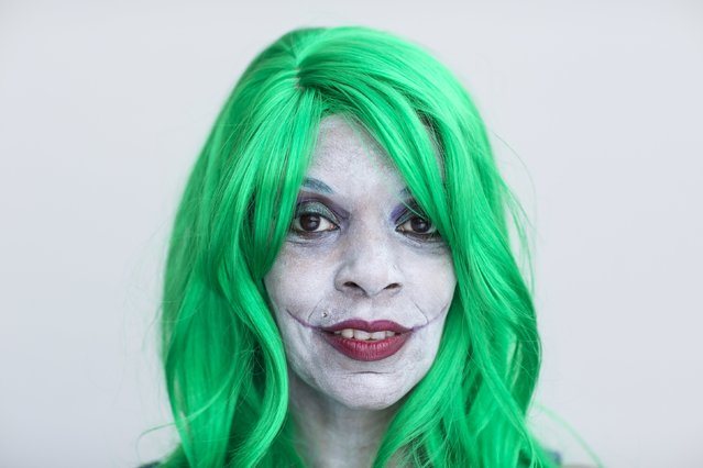 Kiesha Wilkie attends New York Comic Con dressed as a female Joker from DC Comic's Batman comics in Manhattan, New York, October 8, 2015. (Photo by Andrew Kelly/Reuters)