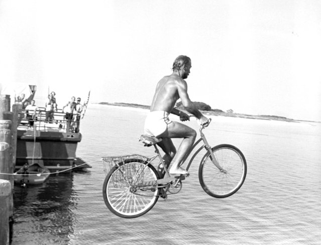 Unconventional bike ride – Fred Hagstrora rides a bicycle into the crystal clear waters off the dock on Fort Jefferson in the Dry Tortugas on August 14, 1981. The island fort is now a historical monument staffed by employees of the National Park Service and used by scientists such as Mr. Hagstrom, who spent a grueling day trying to tag sea turtles for research purposes. The bicycle jump is one way for the island's residents to cool off after a day of work. (Photo by New York Post/Photo Archives, LLC via Getty Images)