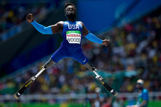 Regas Woods, of the United States, competes in the men's long jump T42 final, during the Paralympic Games, at the Olympic Stadium, in Rio de Janeiro, Brazil, Saturday, September 17, 2016. (Photo by Mauro Pimentel/AP Photo)