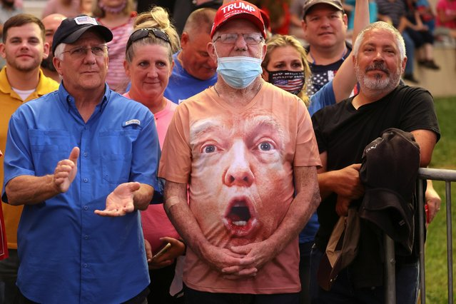 Supporters, one wearing a shirt with U.S. President Donald Trump's face, react as Trump speaks during a campaign event at Smith Reynolds Regional Airport in Winston-Salem, North Carolina, U.S., September 8, 2020. (Photo by Jonathan Ernst/Reuters)