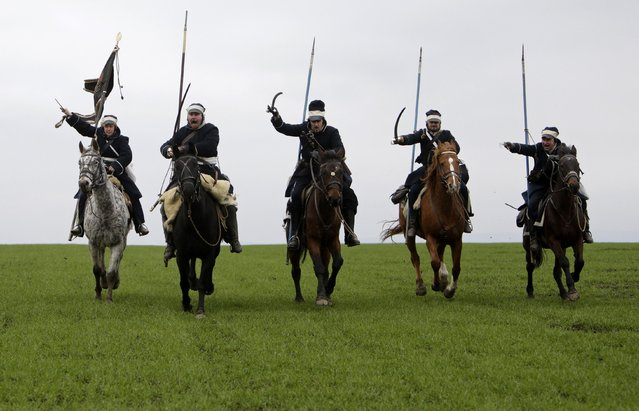 Historical re-enactment enthusiasts dressed as soldiers ride horses near the southern Moravian village of Herspice November 28, 2014. (Photo by David W. Cerny/Reuters)