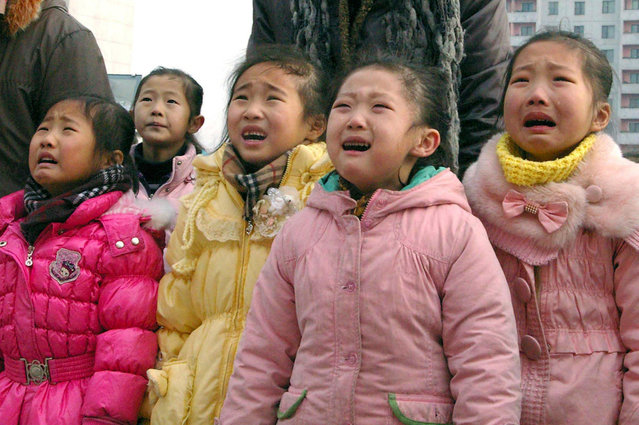 North Korean children mourn their deceased leader Kim Jong Il in Pyongyang, on December 27, 2011 in this photo released by the North's KCNA on December 28, 2011. (Photo by Reuters/KCNA)