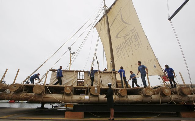 Crew members of the Kon-Tiki II expedition check out the deck of a wooden raft prior to depart to Pascua island in Chile, at Callao port, Peru, October 30, 2015. (Photo by Mariana Bazo/Reuters)