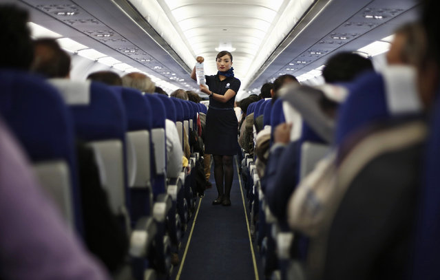 An Indigo Airlines' cabin crew member goes over safety guidelines during a flight from New Delhi to Srinagar city November 21, 2014. (Photo by Adnan Abidi/Reuters)