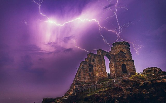 Lightning over Mow Cop Castle which is a folly at Mow Cop in the civil parish of Odd Rode, Cheshire, UK on August 13, 2020, as thunderstorms continue during the current heatwave. (Photo by Lee Scally/Bav Media)
