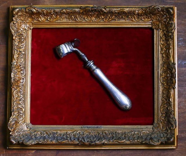 An 18th century tool used by rich people to take food is displayed in an old frame in the Museum of Domenico Agostinelli in Dragona, near Rome October 30, 2014. (Photo by Tony Gentile/Reuters)