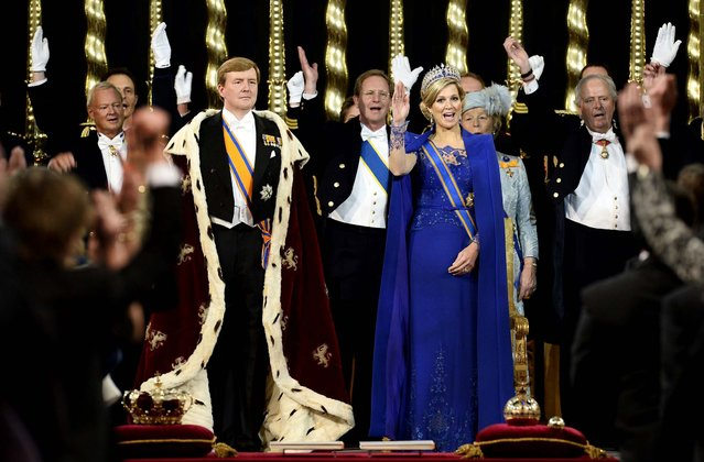 King Willem-Alexander is given three cheers by guests and his wife Queen Maxima inside the Nieuwe Kerk, or New Church, in Amsterdam, during his inauguration, on April 30, 2013. (Photo by Lex van Lieshout/Associated Press)