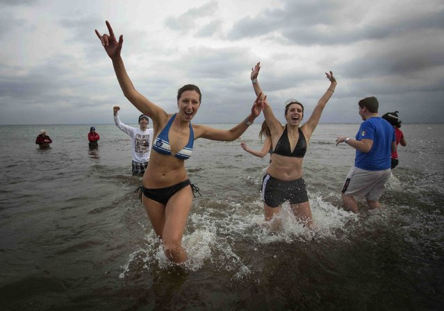 Participants take part in Courage Polar Bear Dip at Coronation Park in Oakville January 1, 2015. (Photo by Mark Blinch/Reuters)