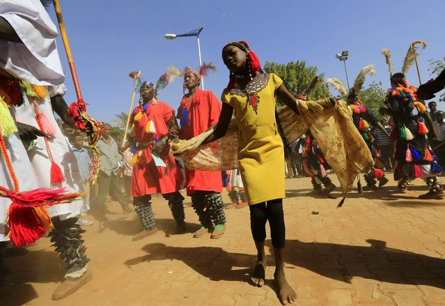 Traditional dancers perform during celebrations to mark Sudan's 59th Independence Day, in Khartoum January 1, 2015. Sudan became independent on January 1, 1956. (Photo by Mohamed Nureldin Abdallah/Reuters)