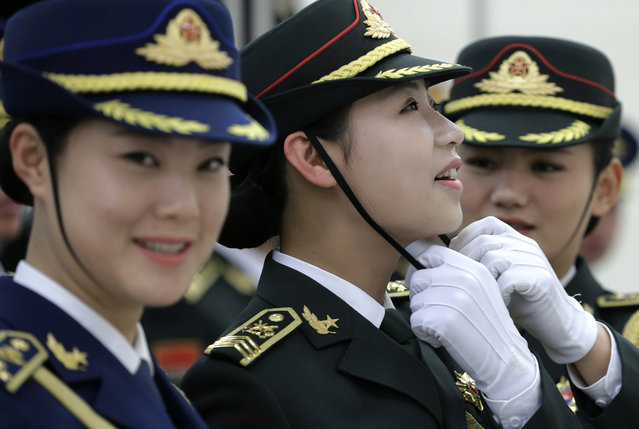 Members of female honor guard prepare at a welcome ceremony for visiting Ecuador's President Rafael Correa at the Great Hall of the People in Beijing, China Wednesday, January 7, 2015. (Photo by Andy Wong/AP Photo)