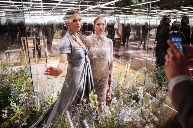 English model Kate Moss, left, and her daughter Lila Grace Moss wear creations for Fendi's Spring-Summer 2021 Haute Couture fashion collection presented Wednesday, January 27, 2021 in Paris, France. (Photo by Francois Mori/AP Photo)