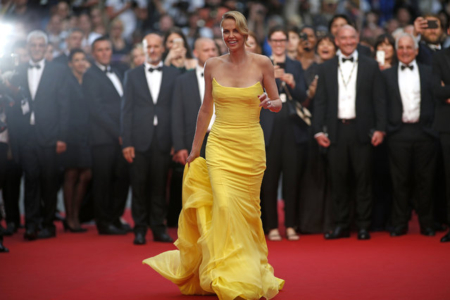 """Charlize Theron poses on the red carpet as she arrives for the screening of the film """"Mad Max: Fury Road"""" out of competition at the 68th Cannes Film Festival, May 14, 2015. (Photo by Benoit Tessier/Reuters)"""