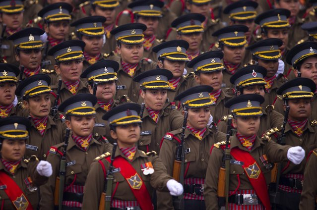 Indian women soldiers march down Rajpath, a ceremonial boulevard that runs from Indian President's palace to war memorial India Gate, during the full dress rehearsal ahead of Republic Day parade in New Delhi, India, Friday, January 23, 2015. (Photo by Saurabh Das/AP Photo)