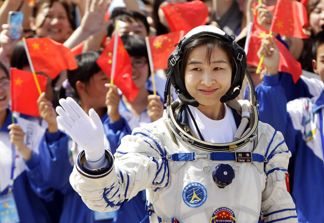 Liu Yang, China's first female astronaut, waves during a departure ceremony at Jiuquan Satellite Launch Center, on June 16, 2012. (Photo by Jason Lee/Reuters via The Atlantic)