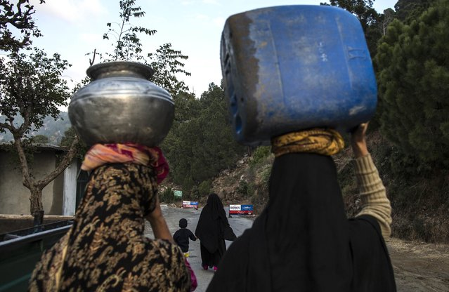 Women carry water as they walk on Margalla Hills in Islamabad January 22, 2015. (Photo by Zohra Bensemra/Reuters)
