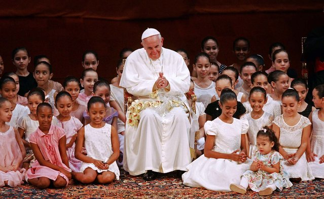 Pope Francis meets with children in the Municipal Theater. (Photo by Carlo Wrede/Agencia O Dia/Reuters)
