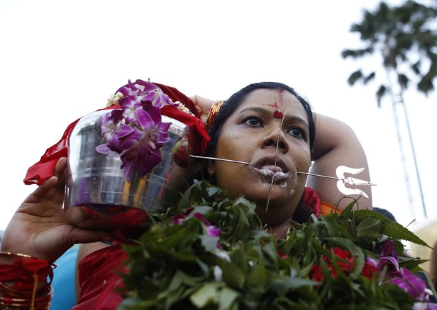 A Hindu devotee is seen on her pilgrimage to the Batu Caves temple during Thaipusam in Kuala Lumpur February 3, 2015. Hindu devotees across Malaysia on Tuesday celebrated Thaipusam, a religious celebration dedicated to the Hindu deity Lord Murugan. (Photo by Olivia Harris/Reuters)