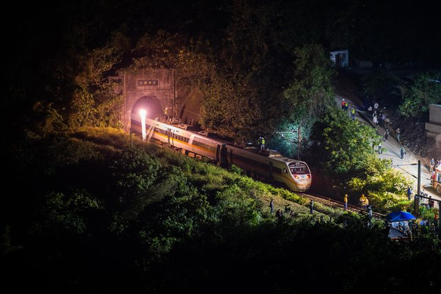 Rescuers work near the site where a train derailed inside a tunnel in the mountains of Hualien, eastern Taiwan on April 2, 2021 in Hualien, Taiwan. Dozens of people are reported to have been killed in the train derailment, the island's worst rail disaster in decades. (Photo by Billy H.C. Kwok/Getty Images)