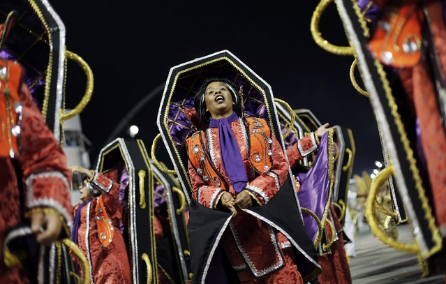 A reveller from Tom Maior Samba School takes part in a carnival at Anhembi Sambadrome in Sao Paulo February 14, 2015. (Photo by Nacho Doce/Reuters)